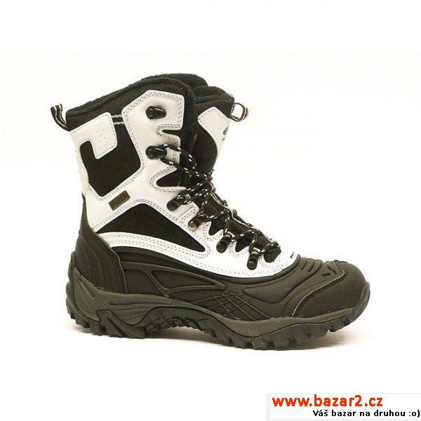 a35289c9f79 Dámské černo-bílé vysoké zimní boty Numero UnoDámská zimní vysoká obuv se  šněrováním na kovové háčky pro lepší regulaci a fixaci obuvi.